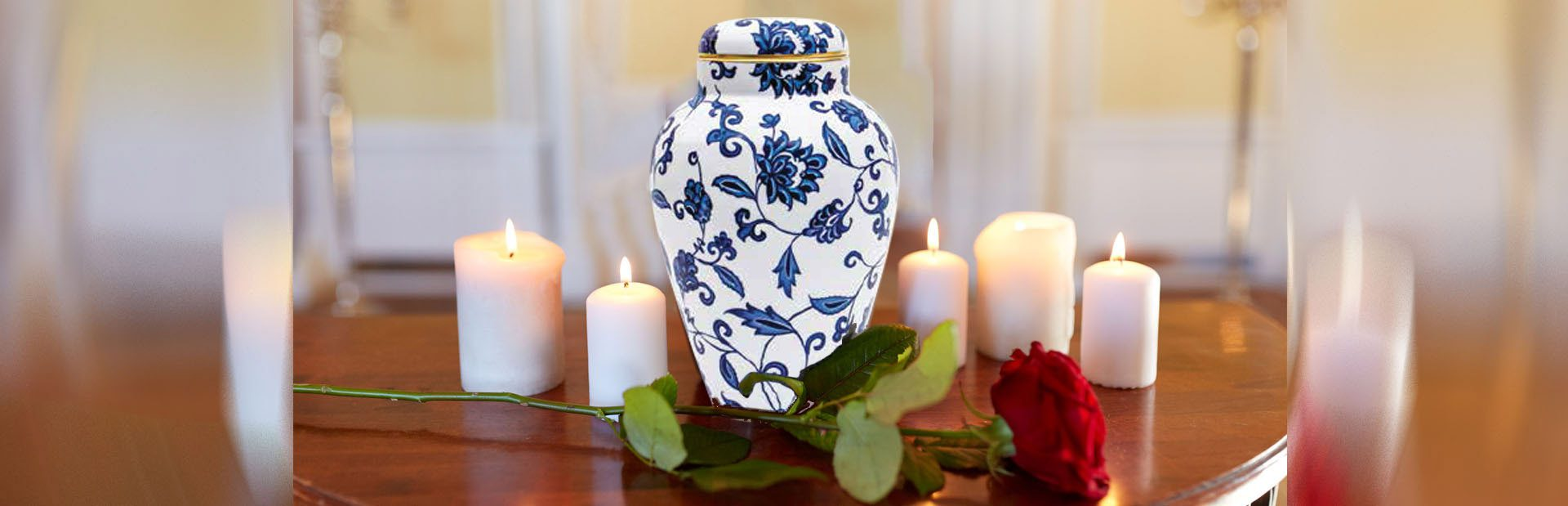 red rose and cremation urn